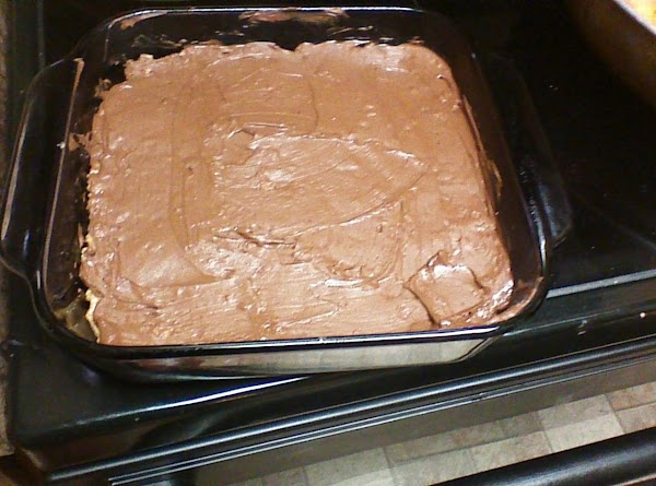 Melt chocolate chips in microwave on medium power stirring every minute until melted. ...