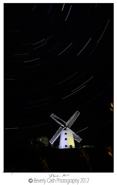 Photo: Hello!  I have had a chance to re-take the image of Llynon Mill on Anglesey, with star trails from a few months ago that came out a bit too bright on the windmill and foggy from moisture. looked like one of the spotlights was out, which helped immensly to keep the windmill from being so bright (No, I swear I didn't sneak in a break it! Was that way when I got there!!). I still used my .75 soft ND grad upside down, as would have been still much too bright for straight imaging. Wasn't humid either, so really good conditions. Have made up for the annoyingly clear skies all week! Lovely to relax about in, but no better for landscapes than all the grey weather we've had otherwise! Did get ok sunset on the day with the haze in the distance giving a nice big, red sun though.  Anyway, new and improved, Llynon Mill with star trails.  Cheers all and thanks for looking and your feedback.