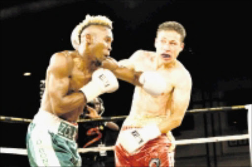 BORING: Zolani Marali fights Gamali Diaz of Mexico on thier IBO Junior Light Weight Title at Emperors Palace in Johannesburg.  03/04/2009. Pic. Antonio Muchave. © Sowetan.