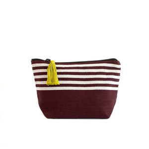 Photo: WORKSHOP/CoOp designed the small tassel bag as the perfect makeup bag for your purse, but it's also a great holder for your cords, adapters, and plugs when traveling. It's a fabulous clutch, and a fun place to store on-the-go snacks for the kids.  Order now: http://www.globalgiving.org/dy/v2/gifts-for-good/detail.html?projectGift.id=56  Your donation will help the UN Refugee Agency-a two-time Nobel Peace Prize winner- provide 11 mosquito nets to protect refugee children and their families from the deadly threat of malaria after fleeing violence in their homeland.   ©Bergonia Photography/WORKSHOP/CoOp