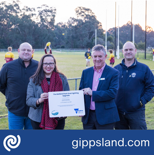 Bellbird Park Committee of Management President Chris Behrendorff, Member for Eastern Victoria Harriet Shing MP, Baw Baw Shire Council Mayor Cr Danny Goss, and Bellbird Park Committee of Management Secretary Michael Caddy celebrate the opening of the Bellbird Park Oval Lighting Upgrade
