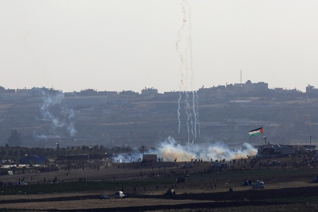 A smoke from the tear gas fired by Israeli troops can be seen from the Israeli side of the border between Israel and Gaza, at the northern Gaza Strip, May 14, 2018.
