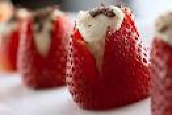 With a small flat grater, grate the chocolate chips over the stuffed strawberries.NOTE: ...