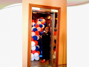 Photo: The balloon lady enters the elevator