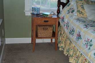 Photo: Cherry bedside table.  Designed to coordinate with Christie's desk (see previous photos), I made two of these. Don't know what we did without them!  18 inches wide, 18 inches deep, and 26 inches high.