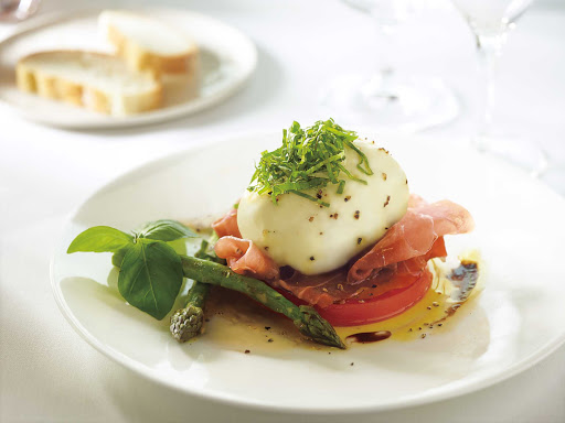 HAL-Main-Dining-Room-David-Burke-Burrata-Salad.jpg - A burrata salad designed by chef David Burke, served in the main dining room of your Holland America cruise.