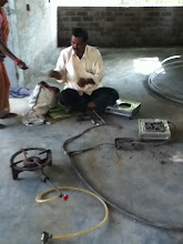 Photo: Jaladhara, the biogas mechanic getting the biogas ready for use