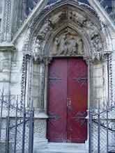 Photo: Also on the north side is the Red Door, decorated between 1250 and 1270 by Pierre de Montreuil (one of the first known architects of the Cathedral, and who also renovated St-Germain-des-Pres and designed Sainte-Chapelle). The central area shows an angel crowning, and Jesus blessing, Mary, while looking on are King Louis IX and Queen Marguerite de Provence, who ruled during the door's construction. On the arches are scenes from the life of St. Marcel, a well-known 5th century Paris bishop.