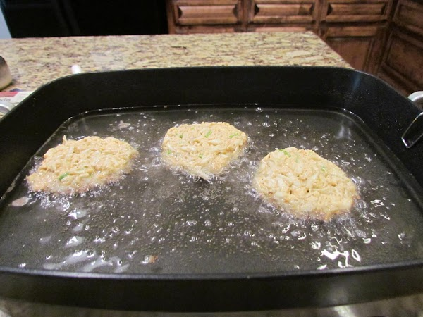 Heat enough oil in skillet {I used electric skillet}to cover crab cakes half way.