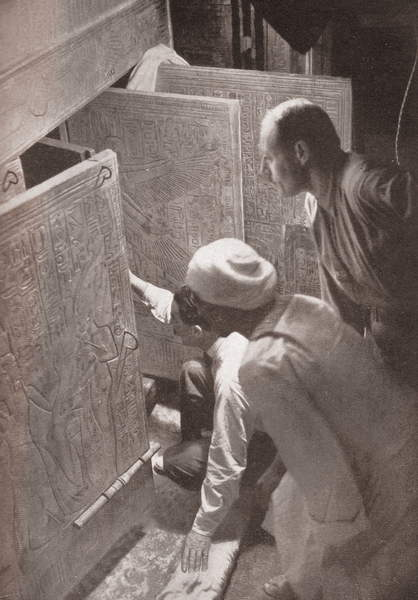 Image of Howard Carter and associates opening the doors of King Tutankhamun's burial shrine in the Valley of the Kings, Egypt; screen print from a photograph, 1923, Photo © GraphicaArtis / Bridgeman Images