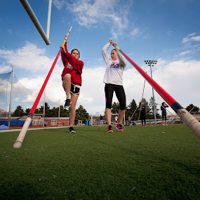 Vaulters by Bill  Brokaw - Sports & Fitness Other Sports ( pole vaulters, track and field, high school, practice, girls sports )