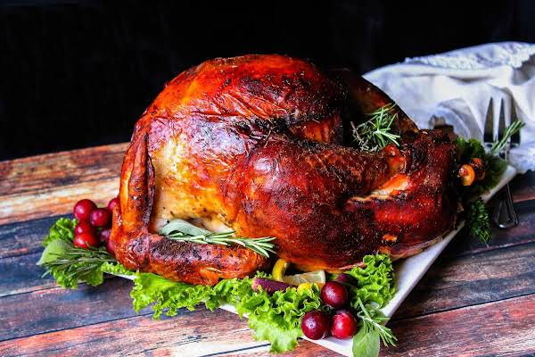 Roast Turkey On A Platter Ready To Be Served.