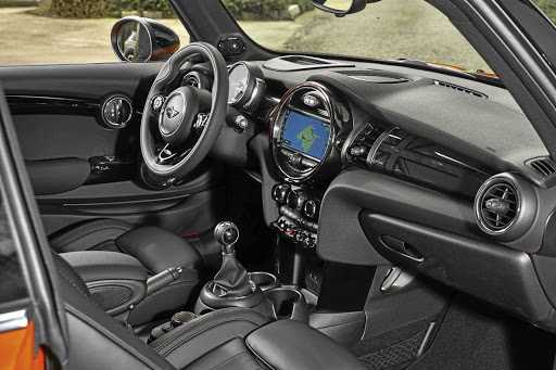 The interior gets a few changes, mainly focused on more Britishness… and tech