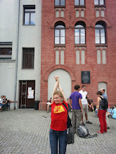 Photo: Alya having a stretch after we finished our visit to the museum. This would not be the last time that her t-shirt would be ironic given our location (and her heritage).