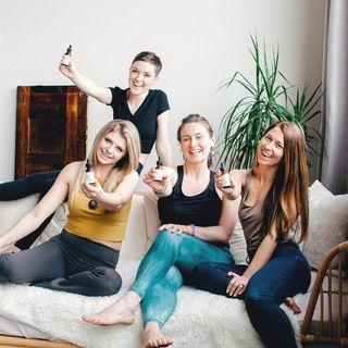 four women smiling and holding blooming botanical cbd tinctures for depression and anxiety