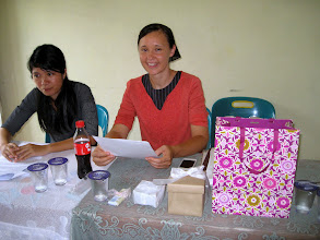 Photo: Rosa teaching at the ladies conference with Agustin as her interpreter.