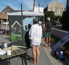 Photo: Pene DiMaio working on her mural