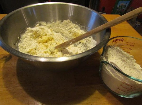 Start gradually adding your flour. Mix until well blended and your able to form...