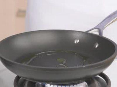 heat canola oil in drying pan until sizzling- then spoon the mixture into the...