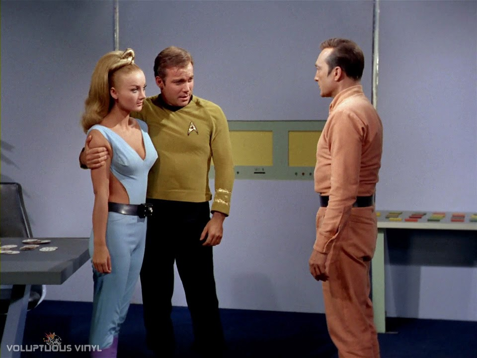 Captain Kirk (William Shatner) holding Kelinda (Barbara Bouchet) in Star Trek.