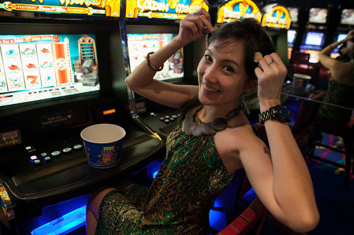 costa-victoria-casino.jpg - Playing the slots in the casino aboard Costa Victoria from Costa Cruises.