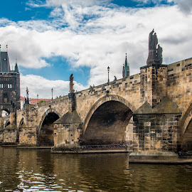 by Mario Horvat - Buildings & Architecture Bridges & Suspended Structures ( sky, visla, prague, bridge, river, clouds, water, popular, arches, tower, czech, touristic )