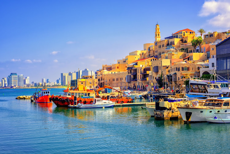 The ancient port town of Jaffa and the modern skyline of Tel Aviv, Israel.