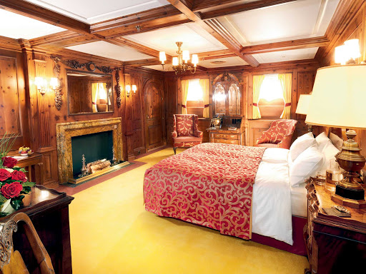 sea-cloud-cabin-2.jpg - Lindblad-National Geographic's Sea Cloud Cabin 2 offers wood-paneled sleeping quarters, a spacious setting and king-size bed.