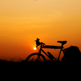 rest by Tonny Haryanto - Landscapes Travel ( colour, pannier, touring, nature, silhouette, sunset, cycling, traveler, travel, rest, bicycle )