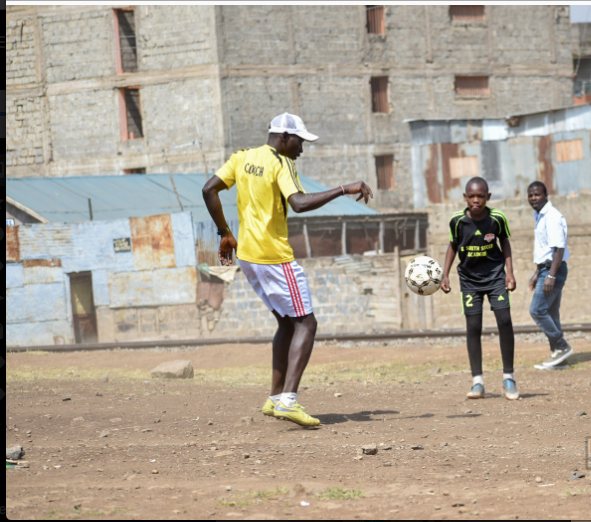 Coach Fred Odhiambo at work with one of his players.