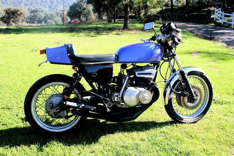 Photo: 74 GT 550: chambers, 32mm carbs, ported, laid down shocks, twin front discs, & shouldered alloy rims. It's a work in progress.