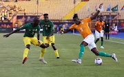 Ivory Coast's Wilfried Zaha in action with South Africa's Thamsanqa Mkhize and Themba Zwane.