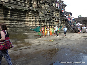 Photo: Locals in traditional dress, and the 20th century steps behind them.