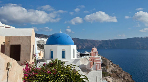 Oia-Santorini-dome.jpg - A blue-topped Greek Orthodox church, with a pink bell tower, in Oia on Santorini, Greece.