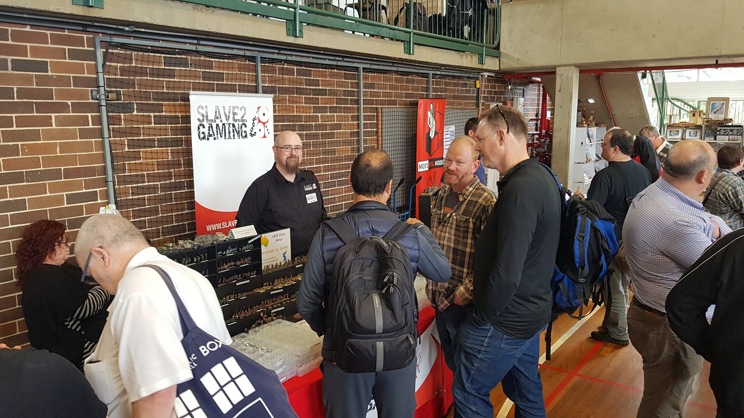 Drew Edney from Slave 2 Gaming talking with customers
