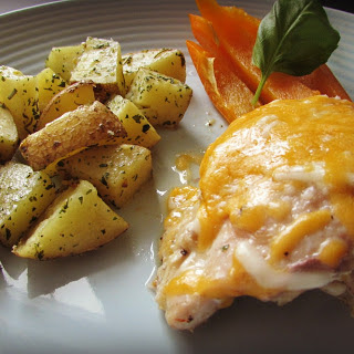 Cheesy Chicken Thighs and Baked Potatoes.