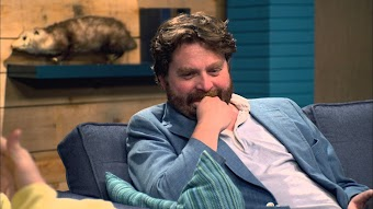 Zach Galifianakis Wears A Blue Jacket & Red Socks