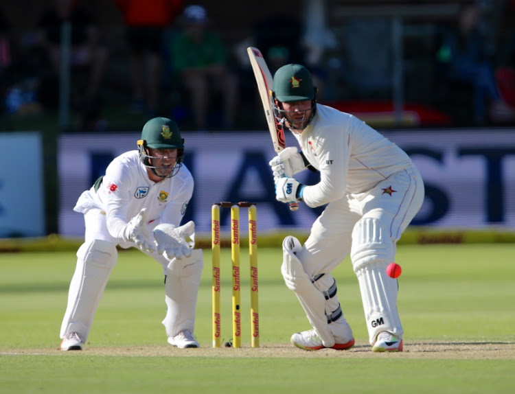 AB de Villiers of South Africa and Brendan Taylor of Zimbabwe during day 2 of the Day/Night Sunfoil Test between South Africa and Zimbabwe at St Georges Park on December 27, 2017 in Port Elizabeth, South Africa.
