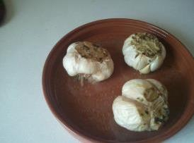 A couple day's ahead.  Soak terra cotta garlic roaster in water for 10-15 minutes. Cut...