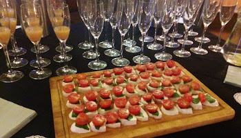 drinks and canapes on a table