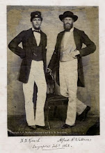 Photo: Alfred Russel Wallace (aged 39) and his friend Frederick Geach in Singapore in February 1862, just before ARW returned to Britain. This is the only known photograph taken of ARW whilst he was in the Malay Archipelago. This is an original print on thin paper which has been pasted onto a sheet of paper. The annotations below the print are in ARW's hand. All other versions of this image are copies of this print. Photographer: Unknown. First published ? Scanned with permission from the original owned by the Wallace family. Copyright of scan: A. R. Wallace Memorial Fund & G. W. Beccaloni.