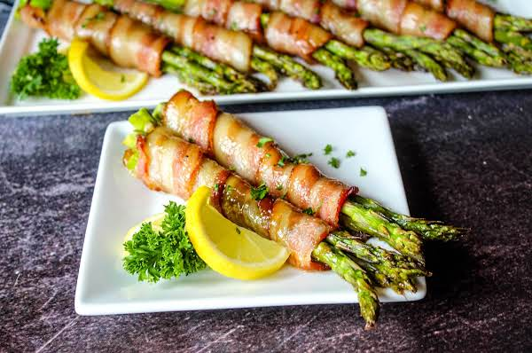 Bacon Wrapped Asparagus On A Plate.