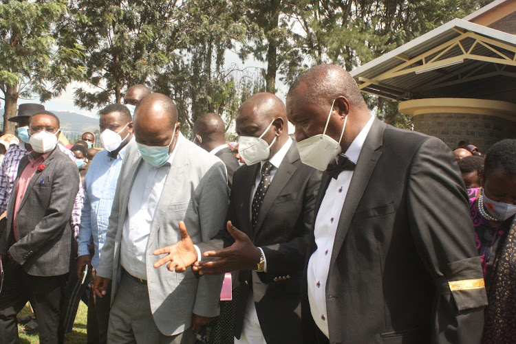 DP William Ruto, Governor Lee Kinyanjui and Bahati MP Kimani Ngunjiri after the memorial service for Edith Wanjiku Ngunjiri, mother to Ngunjiri at St Michael's Catholic Church Maili Sita in Bahati