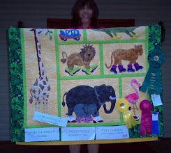 Photo: Here's a closer look at Dolly Campbell with all the ribbons and awards she received for her entry - HBH106 Mom & Me Baby Steps quilt at Maryland State Fair. What a wonderful quilt and an honor for us to display her work in our website.