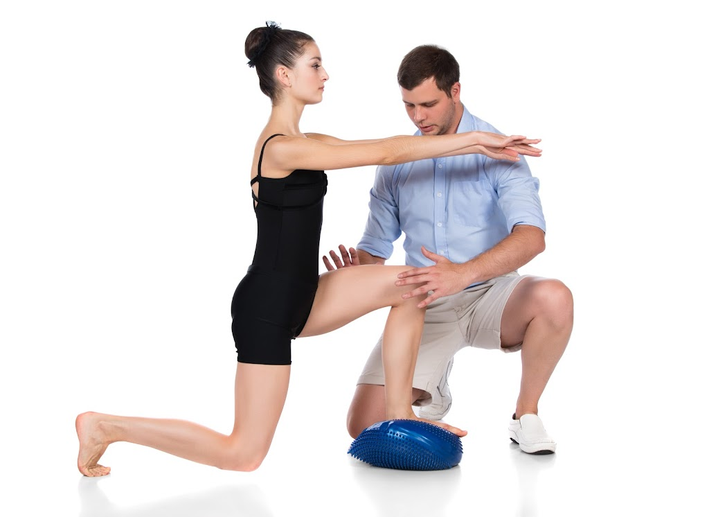 Physical therapist working with a female patient