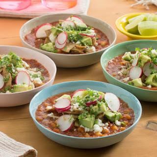 Hominy Tortilla Soup with Queso Fresco & Avocado.