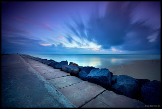 """Photo: """"Indigo Worlds""""  """"Welcome to the lost and forgotten planets...""""  José Ramos © http://www.joseramos.com  Location: Praia da Rocha - Portugal  Technical info:  Exposure - 87 seconds Aperture - f8 ISO - 100 3 stop soft ND Grad filter + 10 stop ND filter  Sony a55 + Sigma 10-20mm"""