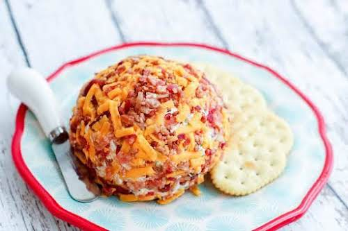"""Bacon Cheese Ball""""Cheese balls are a staple at holiday parties and this..."""
