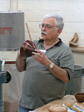 Photo: Master of Ceremonies for Show & Tell, Stuart Glickman, shows a segmented vessel brought by David Jacobowitz.