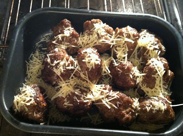 place meatballs in a baking pan, sprinkle with fresh parmesan and cook on low...